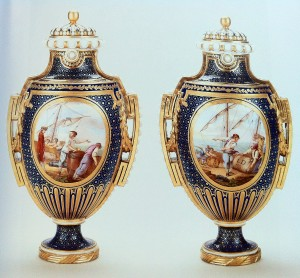 "Figure 7: ""Pair of Vases and Covers; Vase à Panneaux"", Date: c. 1766-1770, Culture: Sèvres, France, Material: Soft-paste Sévres porcelain, dark blue ground (Bleu Nouveau), painted by Jean-louis Morin (who used the lower case 'm' as his signature) in the late 1760's or early 1770's. Measurements: Heights: 30.5, Widths: 17.5 and 17.6, Depths: 13.8 and 13.9."